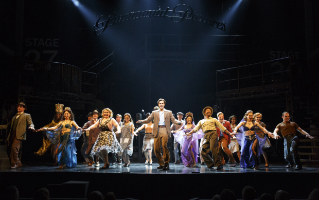 <p>Michael Xavier (center) leads the company in a number from <em>Sunset Boulevard</em>.</p><br />(© Joan Marcus)
