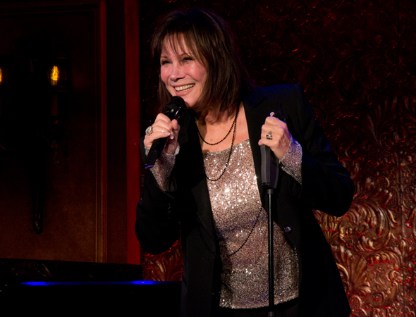 <p>Michele Lee welcomes the assembled press to 54 Below.</p><br />(© David Gordon)