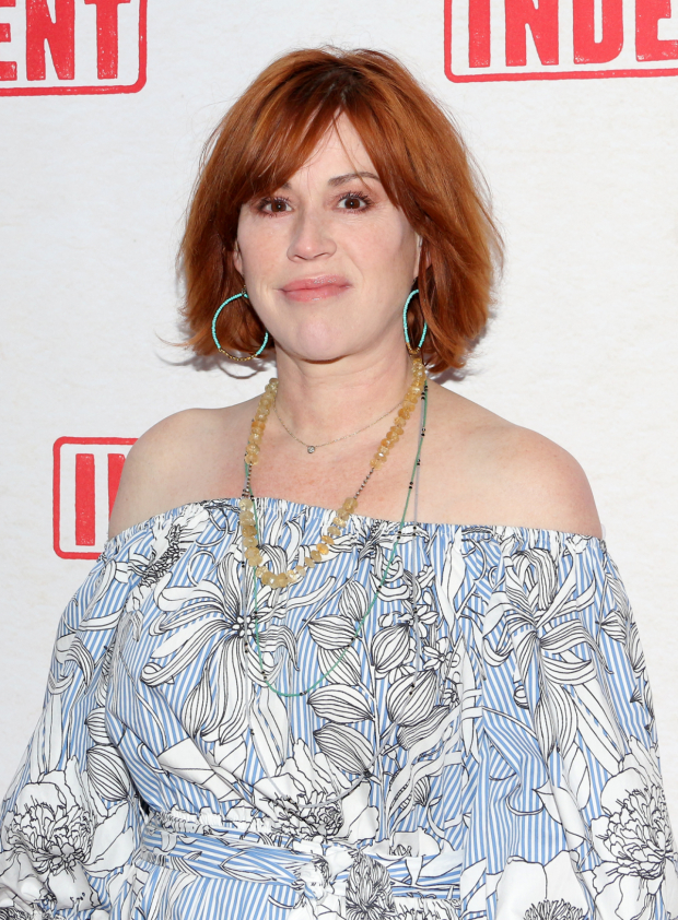 <p>Molly Ringwald stopped for a photo on her way to the show.</p><br />(© David Gordon)