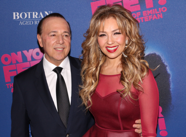 <p>Music mogul Tommy Mottola joins his wife, singer Thalía, for a snapshot before the show.</p><br />(© David Gordon)