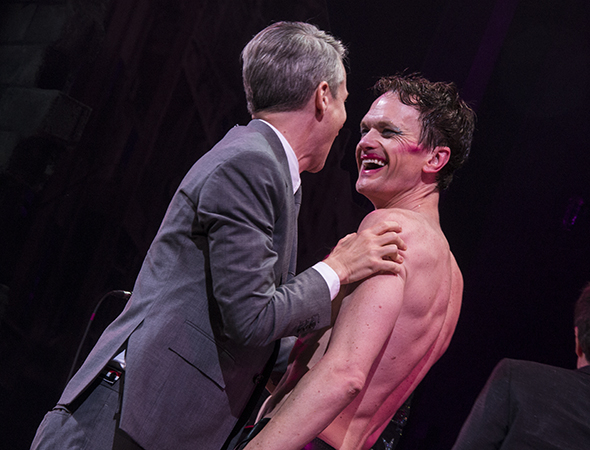 <p>Neil Patrick Harris is congratulated by show coauthor John Cameron Mitchell.</p><br />(© David Gordon)