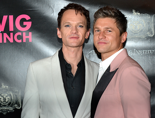 <p>Neil Patrick Harris poses alongside his partner, David Burtka.</p><br />(© David Gordon)