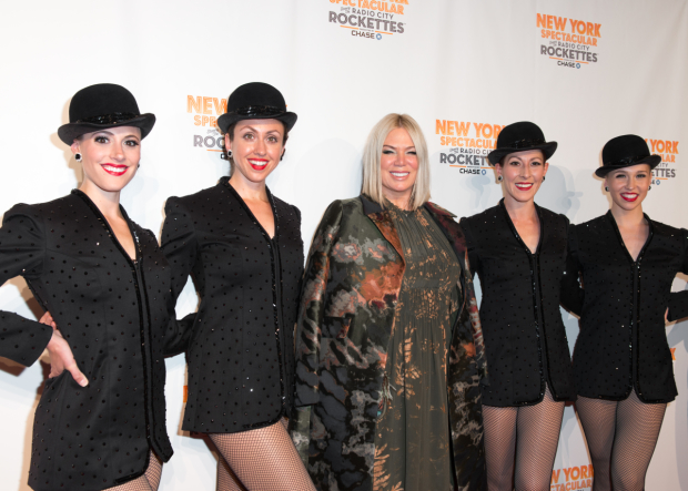 <p><em>New York Spectacular</em> director and choreographer Mia Michaels is flanked by Rockettes from the production.</p><br />(© Allison Stock)