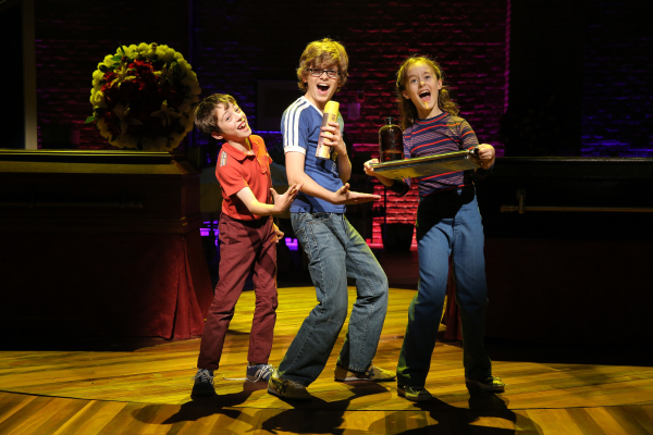 <p>Noah Hinsdale, Griffin Birney, and Sydney Lucas rehearse some new moves.</p><br />(© Joan Marcus)