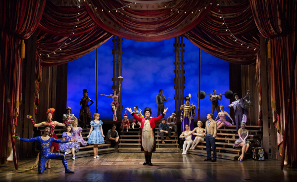 <p>Norbert Leo Butz (Edward Bloom) and Kate Baldwin (Sandra Bloom) share a look across a room full of circus performers.</p><br />(© Paul Kolnik)