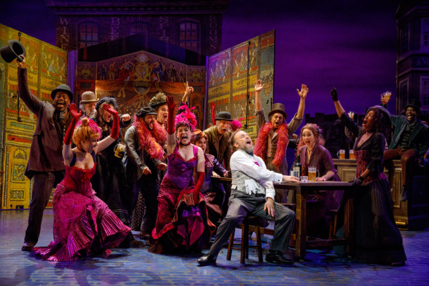 <p>Norbert Leo Butz has a raucous  time with the ensemble of <em>My Fair Lady</em>.</p><br />(© Joan Marcus)