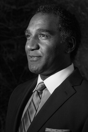 <p>Norm Lewis caught in a candid moment in front of the cameras.</p><br />(© Seth Walters)