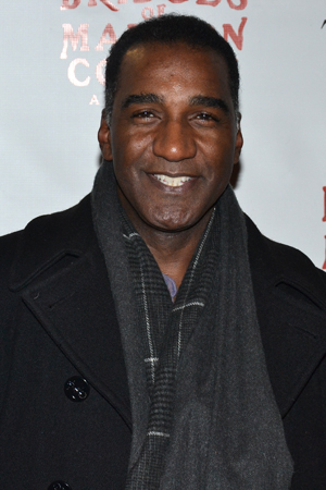 <p>Norm Lewis smiles for the cameras on his way into the Schoenfeld Theatre.</p><br />(© David Gordon)