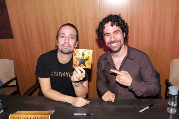 <p>October 16, 2015: Miranda and Lacamoire show off a signed copy of the newly released double-disc <em>Hamilton</em> cast album.</p><br />(© David Gordon)