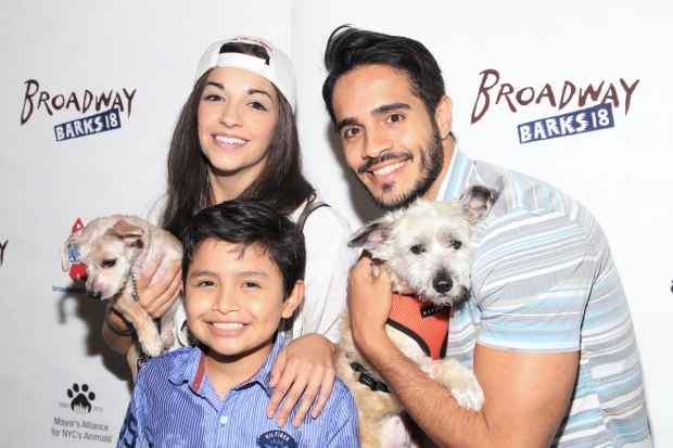 <p><em>On Your Feet!</em> stars Ana Villafañe, Eduardo Hernandez, and Ektor Rivera are excited to spend the afternoon playing with puppies.</p><br />(© Tricia Baron)