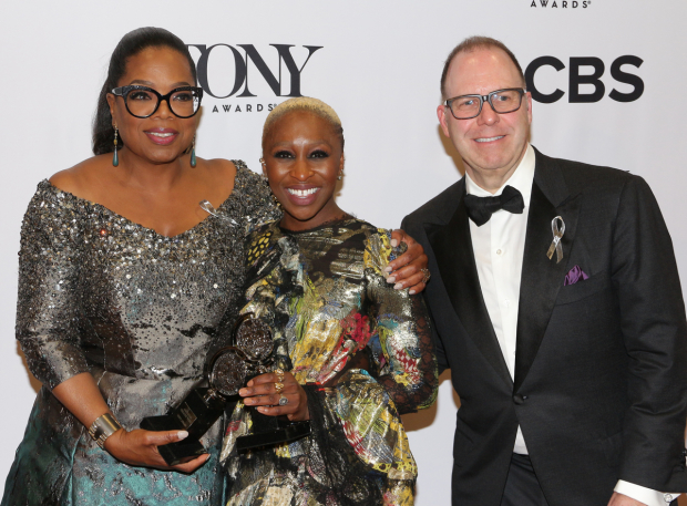 <p>Oprah Winfrey, Cynthia Erivo, and Scott Sanders celebrate the win of <em>The Color Purple</em>.</p><br />(© David Gordon)