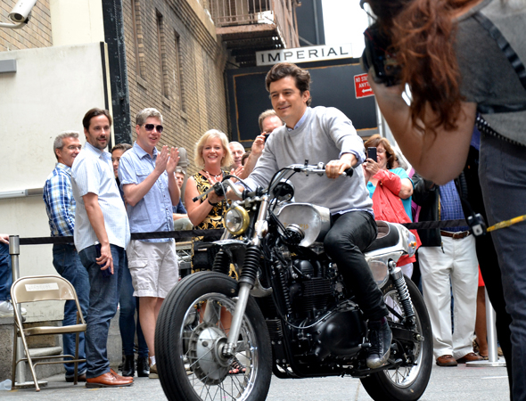 <p>Orlando Bloom rides up to the Richard  Rodgers Theatre on a motorcycle.</p><br />(© David Gordon)