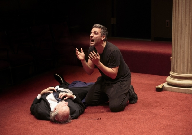 <p>Oscaar Isaac as Hamlet kneels above Peter Friedman as Polonius.</p><br />(© Carol Rosegg)