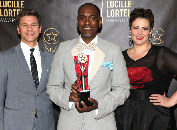 <p>Outstanding Costume Design winner Paul Tazewell (center) is flanked by presenters David Burtka and Lisa Howard of Broadway&#39&#x3B;s <em>It Shoulda Been You</em>.</p><br />(© David Gordon)