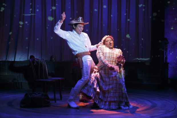 <p>Paolo Montalban puts on a show for Ashley D. Kelley.</p><br />(© Joan Marcus)