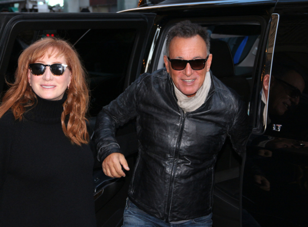 <p>Patti Scialfa Springsteen and Bruce Springsteen head into the Walter Kerr Theatre.</p><br />(© David Gordon)