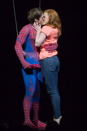 <p>Peter Parker (Justin Matthew Sargent) and Mary Jane Watson (Rebecca Faulkenberry) share a kiss.</p><br />(© Seth Walters)