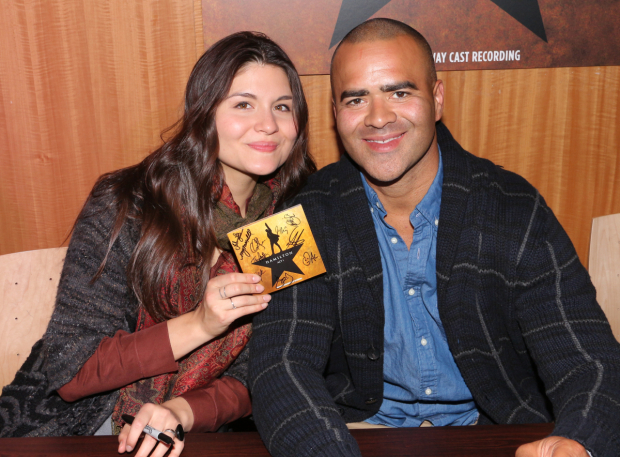 <p>Phillipa Soo and Christopher Jackson are thrilled to sign <em>Hamilton</em> albums.</p><br />(© David Gordon)