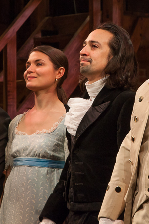 <p>Onstage wife and husband Phillipa Soo and Lin-Manuel Miranda drink in the applause. </p><br />(© Seth Walters)