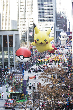 <p>Pikachu and the Pillsbury Doughboy make their way down the parade route.</p><br />(© David Gordon)