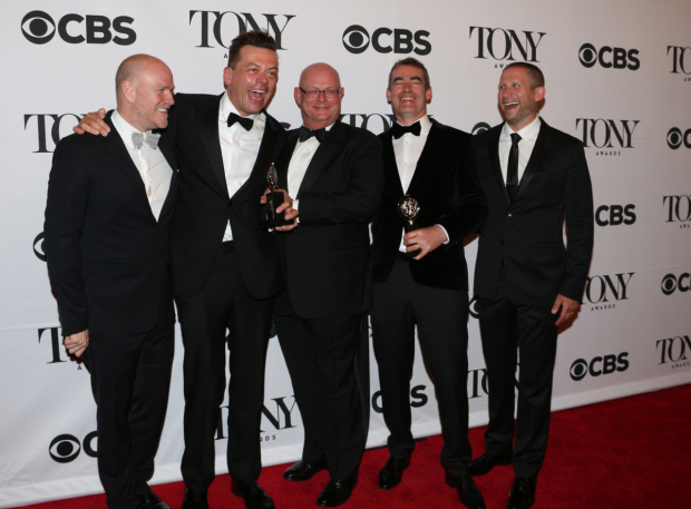 <p>Playwright Simon Stephens (second from left) and the producing team of <em>The Curious Incident of the Dog in the Night-Time</em> have a laugh after their Best Play win.</p><br />(© David Gordon)