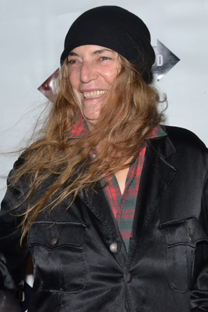 <p>Punk rocker Patti Smith is a little windblown as she arrives at the Cort Theatre.</p><br />(© David Gordon)