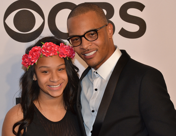 <p>Rap artist T.I. smiles for the cameras with his daughter.</p><br />(© David Gordon)