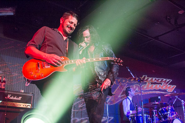 <p>Reserved for Rondee guitarist Nick Fokas plays with Constantine Maroulis.</p><br />(© Seth Walters)
