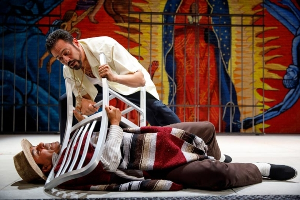 <p>Reza Salazar finds himself pinned by Juan Francisco Villa.</p><br />(© Joan Marcus)