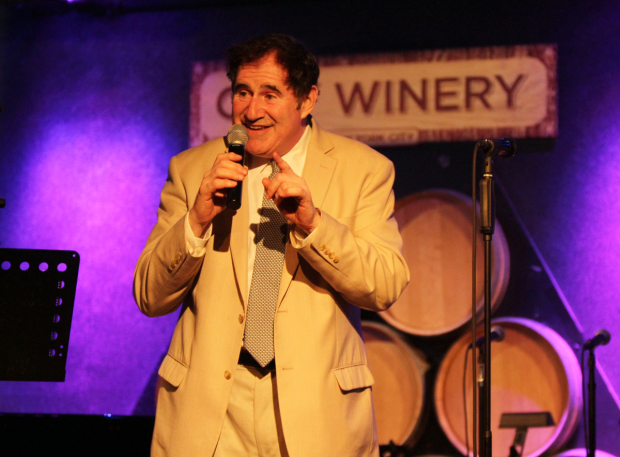 <p>Richard Kind served as auctioneer for the evening.</p><br />(© Henry McGee)
