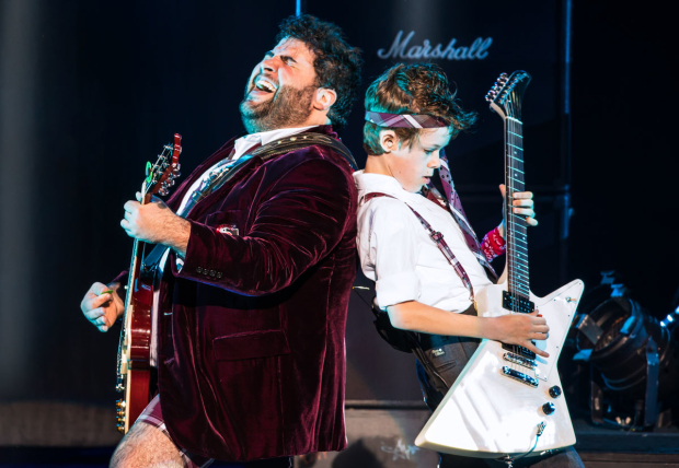 <p>Rob Colletti and Phoenix Schuman shred away in <em>School of Rock</em>.</p><br />(© Matthew Murphy)
