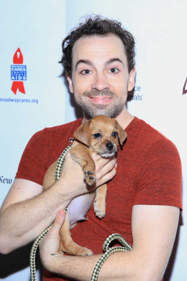 <p><em>Something Rotten!</em> star Rob McClure smiles for the camera with a furry little pal.</p><br />(© Tricia Baron)