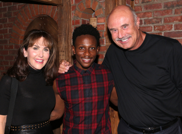 <p>Robin and Phil McGraw flank cast member Gregory Haney backstage.</p><br />(© David Gordon)