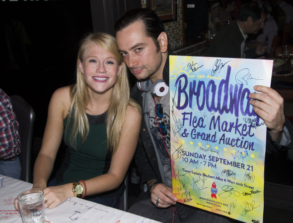 <p><em>Rock of Ages</em> stars Carrie St. Louis and Constantine Maroulis sign autographs for a good cause.</p><br />(© David Gordon)