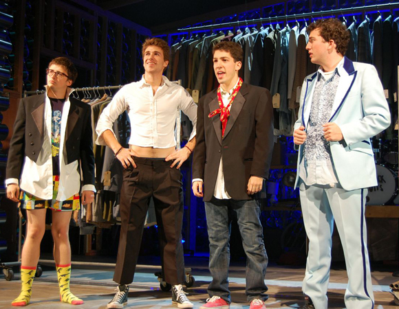 <p>Roland, Brewer, Getzug, and Chad dress for success.</p><br />(© TheaterMania)