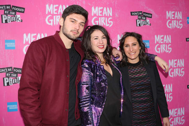 <p>Rosalind Wiseman (right), the author of <em>Mean Girls</em> source material <em>Queen Bees and Wannabes</em>, walks the pink carpet with her family.</p><br />(© David Gordon)