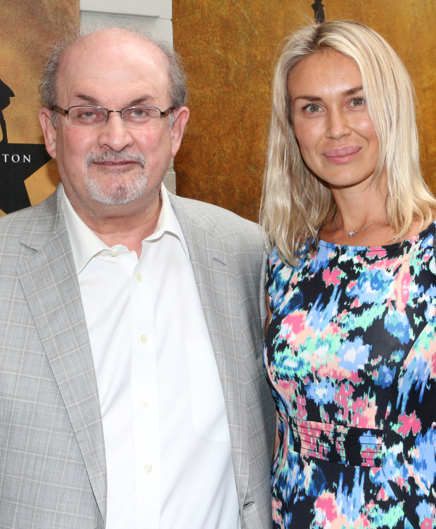 <p>Author Salman Rushdie arrives for the show with a lovely date on his arm.</p><br />(© David Gordon)