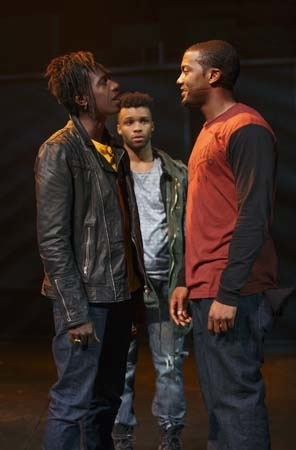 <p>Saul Williams, Dyllon Burnside, and Joshua Boone have a confrontation in <em>Holler If Ya Hear Me</em>.</p><br />(© Joan Marcus)