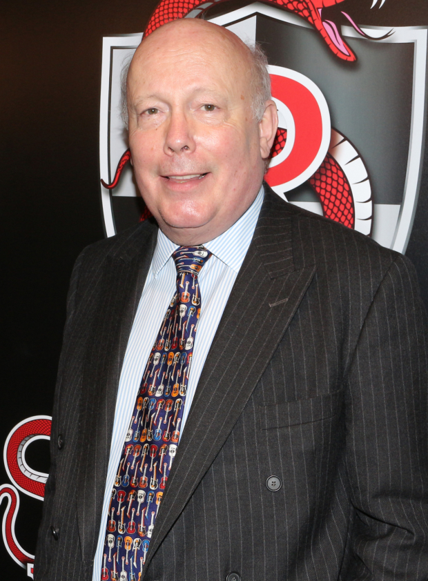 <p><em>School of Rock</em> book writer Julian Fellowes proudly takes in the opening-night festivities at the Hard Rock Café.</p><br />(© David Gordon)
