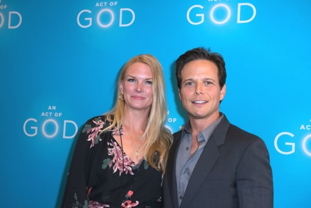 <p>Scott Wolf and Kelly Wolf head into the Booth Theatre.</p><br />(© Allison Stock)