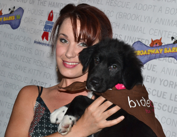 <p>Sierra Boggess poses with her new four-legged friend</p><br />(© David Gordon)
