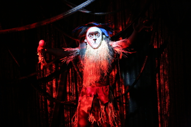 <p>Sinclair Mitchell makes a frightening entrance as the Witch Doctor in <em>The Emperor Jones</em>.</p><br />(© Carol Rosegg)