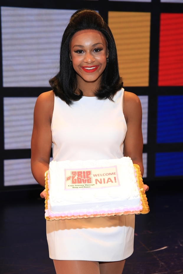 <p>Sioux shows off the <em>Trip of Love</em>&#39&#x3B;s celebratory 300th performance cake.</p><br />(© Tricia Baron)