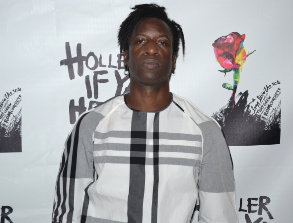 <p>Slam poet Saul Williams leads the cast of <em>Holler If Ya Hear Me</em> as reformed convict John.</p><br />(© David Gordon)
