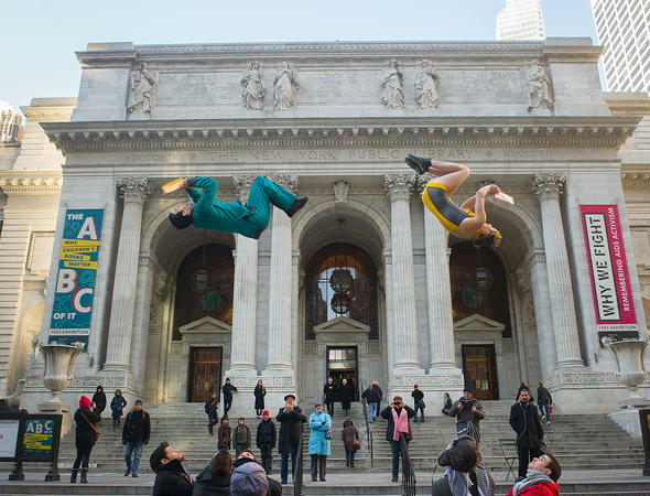 <p>Somersaulting at the New York Public Library.</p><br />(© Jordan Matter)