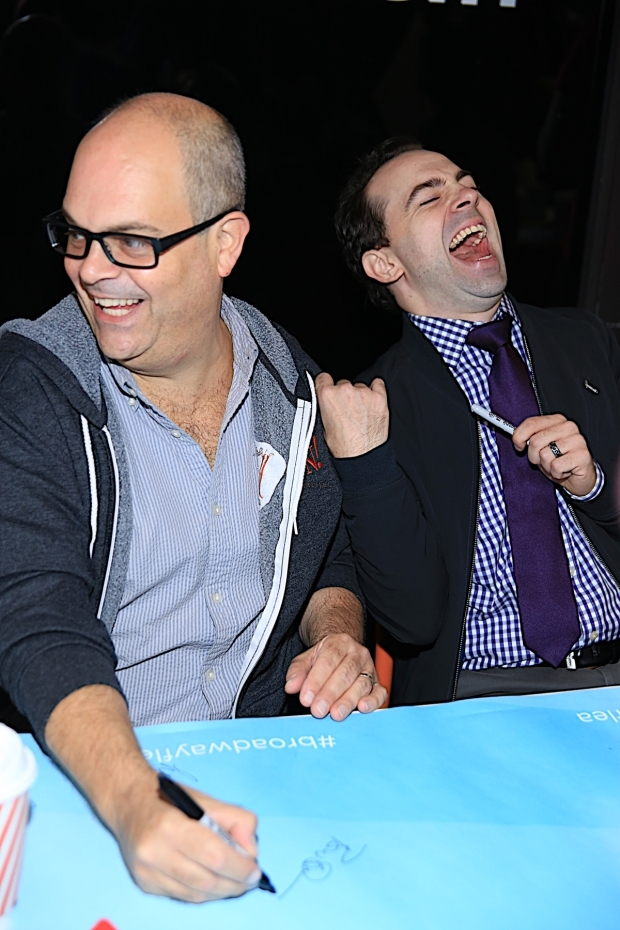<p><em>Something Rotten!</em> costars Brad Oscar and Rob McClure have a laugh at the Broadway Flea Market&#39&#x3B;s autograph table.</p><br />(© Tricia Baron)