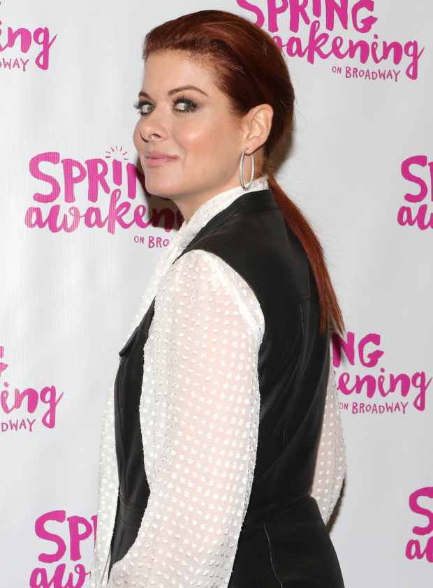 <p>Stage and screen favorite Debra Messing works the red carpet as she arrives at the Brooks Atkinson Theatre.</p><br />(© David Gordon)