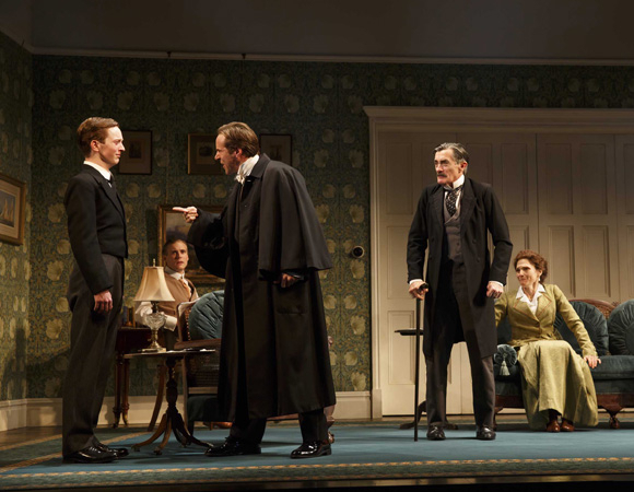 <p>Star barrister and fabulous topcoat owner Sir Robert Morton (Alessandro Nivola) interrogates Ronnie Winslow (Spencer Davis Milford). Dickie (Zachary Booth), Arthur (Roger Rees), and Grace (Mary Elizabeth Mastrantonio) look on.</p><br />(© Joan Marcus)