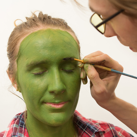 <p>Step 4: Highlight your eyebrows with Mehron black face paint.</p><br />(© Tristan Fuge)