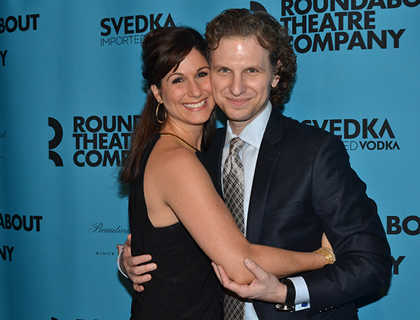 <p>Stephanie J. Block and Sebastian Arcelus snuggle together on the red carpet.</p><br />(© David Gordon)